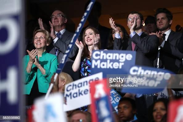 Sen Elizabeth Warren Chelsea Clinton and husband Marc Mezvinsky applaud former US President Bill Clinton on the second day of the Democratic National...