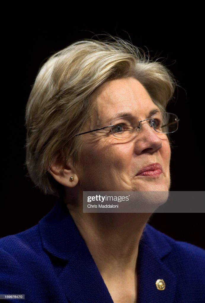 Sen. Elizabeth Warren, D-Mass., introduces Senate Foreign Relations Chairman Sen. John Kerry, D-Mass., President Barack Obama's nominee to become secretary of state, at his confirmation hearing before the Senate Foreign Relations committee to replace Hillary Rodham Clinton.