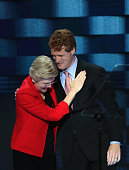 Sen Elizabeth Warren embraces Rep Joseph P Kennedy III after being introduced on the first day of the Democratic National Convention at the Wells...