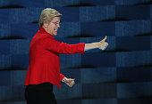 Sen Elizabeth Warren gives a thumbs up to the crowd as she walks off after delivering remarks on the first day of the Democratic National Convention...