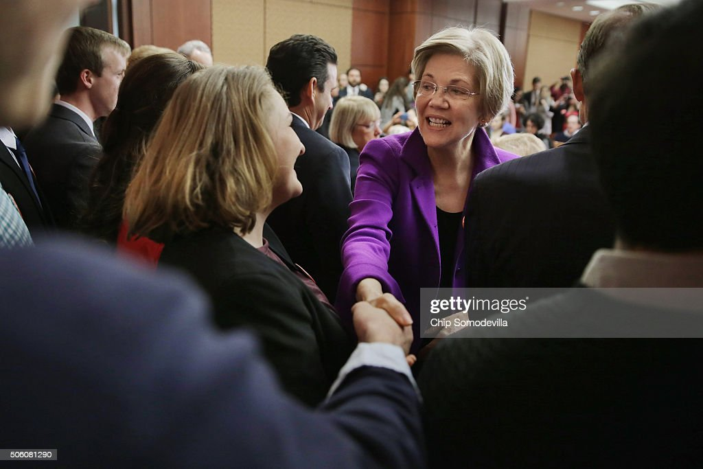 Sen. Elizabeth Warren (D-MA) greets college students before a news conference to unveil a legislative package to address college affordability in the U.S. Capitol Visitors Center College January 21, 2016 in Washington, DC. The Democratic senators hope to 'put America on path toward debt-free college education.'