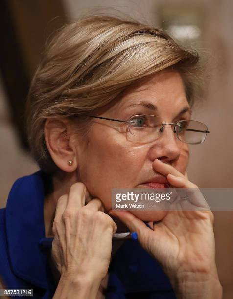 Sen Elizabeth Warren listens to former Equifax CEO Richard Smith during a Senate Banking Housing and Urban Affairs Committee hearing in the Hart...