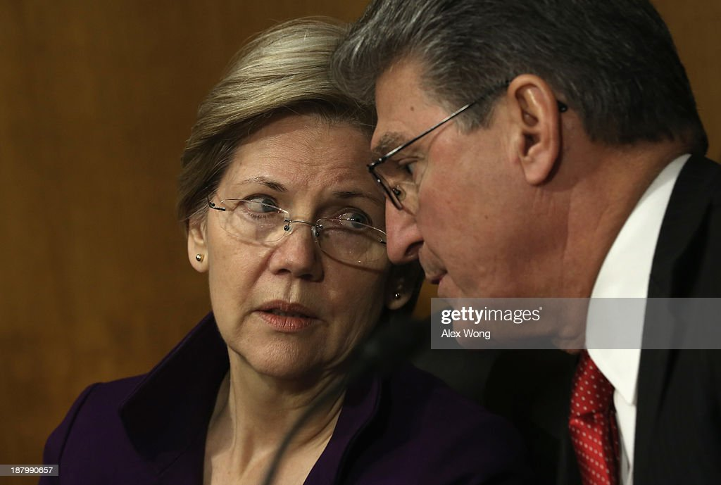U.S. Sen. Elizabeth Warren (D-MA) (L) listens to Sen. <a gi-track='captionPersonalityLinkClicked' href=/galleries/search?phrase=Joe+Manchin&family=editorial&specificpeople=568465 ng-click='$event.stopPropagation()'>Joe Manchin</a> (D-WV) (R) during a confirmation hearing for Nominee for the Federal Reserve Board Chairman Janet Yellen before Senate Banking, Housing and Urban Affairs Committee November 14, 2013 on Capitol Hill in Washington, DC. Yellen will be the first woman to head the Federal Reserve if confirmed by the Senate and will succeed Ben Bernanke.