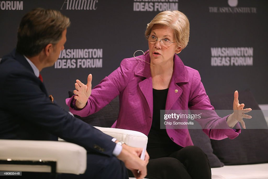 Sen. Elizabeth Warren (D-MA) (R) participates in a question-and-answer interview with CNN host Jake Tapper during the seventh annual Washington Ideas Forum at the Harman Center for the Arts October 1, 2015 in Washington, DC. Warren continued to talk about issues that are important to her, including income inequality, during the forum, which was organized by The Atlantic and the Aspen Institute.