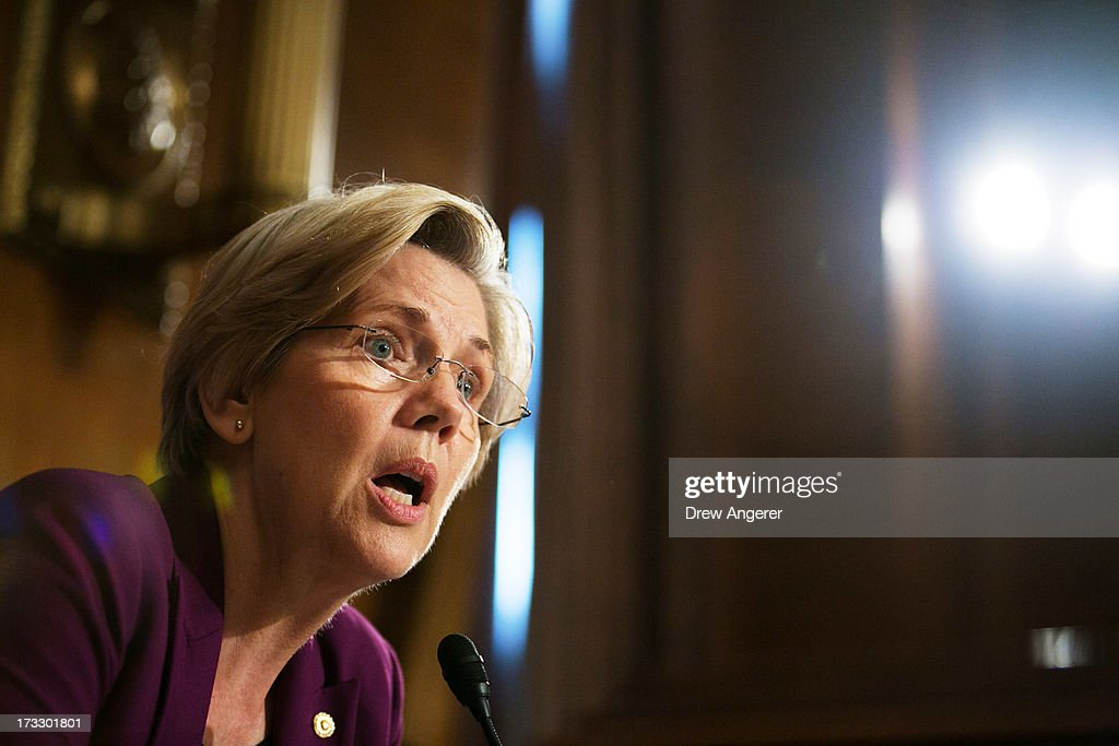 U.S. Sen. <a gi-track='captionPersonalityLinkClicked' href=/galleries/search?phrase=Elizabeth+Warren&family=editorial&specificpeople=5396017 ng-click='$event.stopPropagation()'>Elizabeth Warren</a> (D-MA) questions witnesses during a Senate Banking, Housing and Urban Affairs Committee hearing on 'Mitigating Systemic Risk Through Wall Street Reforms,' on Capitol Hill, July 11, 2013 in Washington, DC. The committee heard from the panel about the progress being made on reform provisions that improve financial stability.