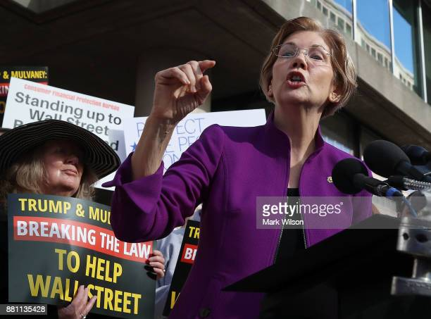 Sen Elizabeth Warren speaks during a protest in front of the Consumer Financial Protection Bureau headquarters on November 28 2017 in Washington DC...
