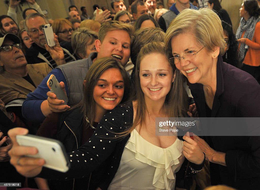U.S. Sen. Elizabeth Warren (D-MA) takes time out for a quick photo with Lailey Barbour, Caroline Closson and Riley Willman during a campaign rally for U.S. Rep. Bruce Braley (D-IA) on October 19, 2014 in Des Moines, Iowa. Braley is in a tight race for a Senate seat against Republican challenger Joni Ernst.