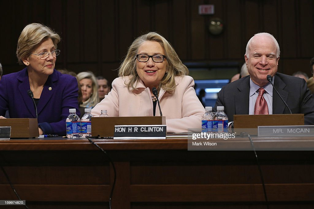 Sen. Elizabeth Warren (D-MA), U.S. Secretary of State Hillary Clinton and Sen. John McCain (R-AZ) introduce Sen. John Kerry (D-MA) during his confirmation hearing before the Senate Foreign Relations Committee to become the next Secretary of State in the Hart Senate Office Building on Capitol Hill January 24, 2013 in Washington, DC. Nominated by President Barack Obama to succeed Hillary Clinton as Secretary of State, Kerry has served on this committee for 28 years and has been chairman for four of those years.