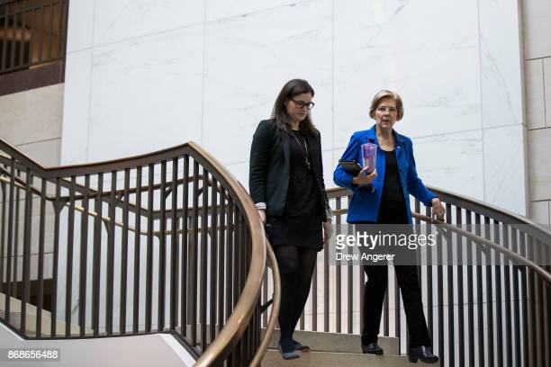 Sen Elizabeth Warren walks to a closed briefing about recent Navy collisions at sea October 31 2017 in Washington DC Members of the Senate Armed...