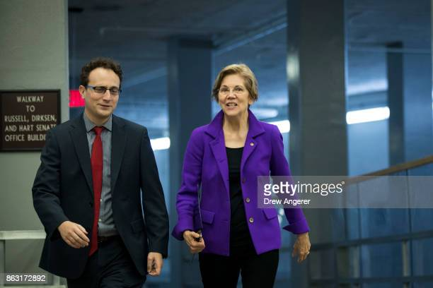 Sen Elizabeth Warren walks with an aide as she makes her way to a vote on amendments to the fiscal year 2018 budget resolution on Capitol Hill...