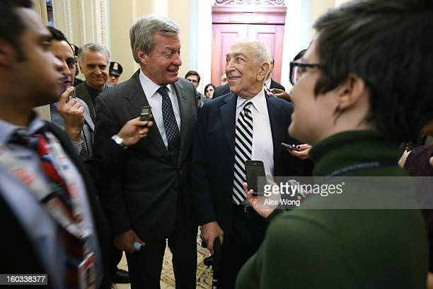 S Sen Frank Lautenberg and Sen Max Baucus share a moment as they arrive at the weekly Senate Democratic Policy Luncheon at the US Capitol January 29...