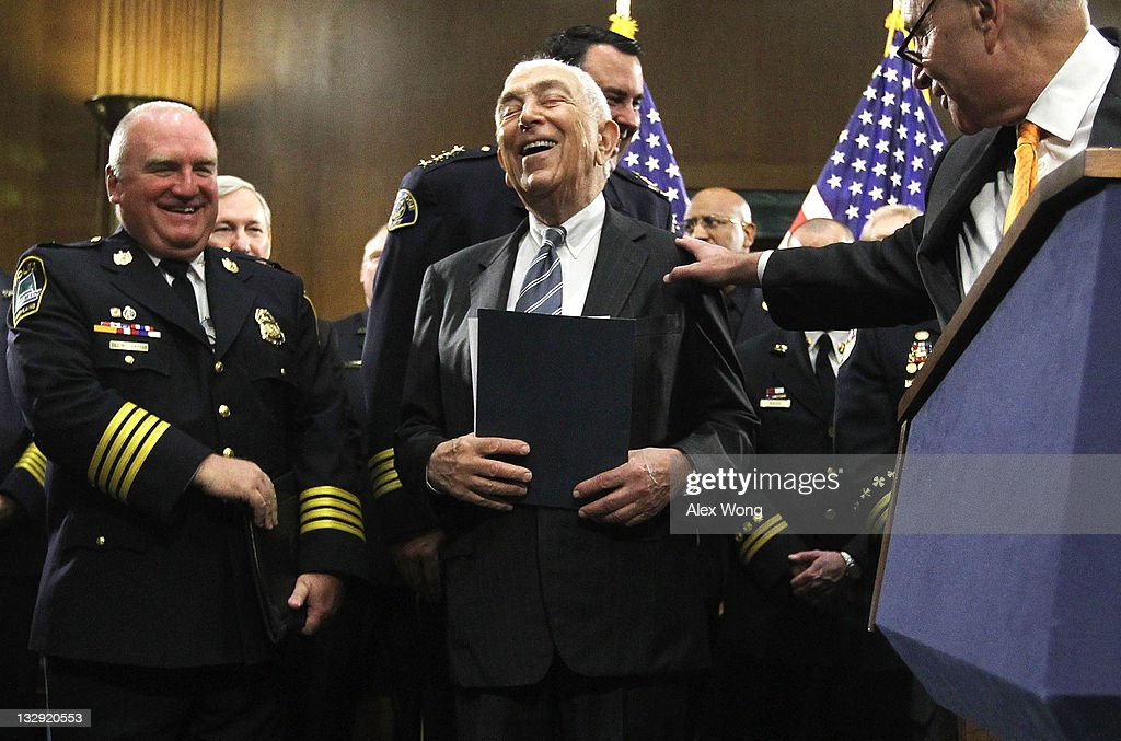 U.S. Sen. <a gi-track='captionPersonalityLinkClicked' href=/galleries/search?phrase=Frank+Lautenberg&family=editorial&specificpeople=240397 ng-click='$event.stopPropagation()'>Frank Lautenberg</a> (D-NJ) (C) laughs with Sen. <a gi-track='captionPersonalityLinkClicked' href=/galleries/search?phrase=Charles+Schumer&family=editorial&specificpeople=171249 ng-click='$event.stopPropagation()'>Charles Schumer</a> (D-NY) (R) during a news conference November 15, 2011 on Capitol Hill in Washington, DC. The news conference was to call for the Joint Select Committee on Deficit Reduction, also known as the Supercommittee, to include legislation to provide first responders and public safety officials with better communications network.