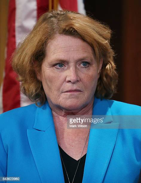 Sen Heidi Heitkamp attends a news conference to discuss the Senate's recent failed vote for funding to fight the Zika virus on Capitol Hill June 29...
