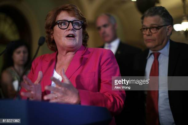 S Sen Heidi Heitkamp speaks as Sen Al Franken listens during a news briefing after the weekly Senate Democratic Policy Luncheon July 11 2017 at the...