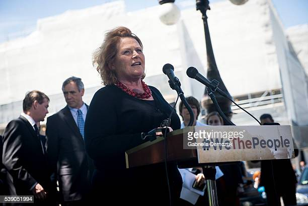 Sen Heidi Heitkamp speaks to reporters at a news conference dubbed #WeThePeople outside the Capitol on June 9 2016 in Washington DC Senate Democrats...