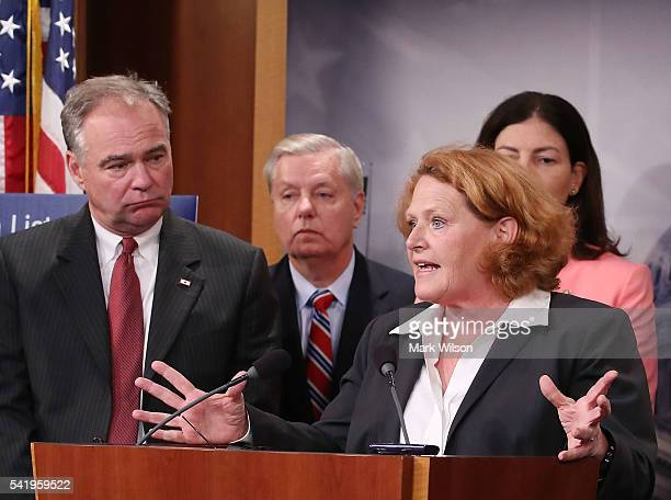 Sen Heidi Heitkamp speaks while flanked by bipartian Senate colleagues during a news conference on Capitol Hill June 21 2016 in Washington DC...