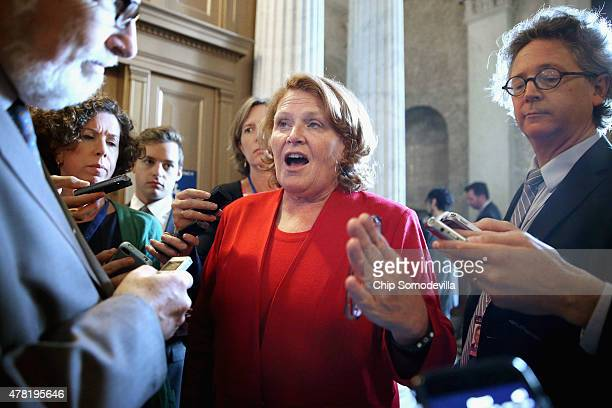 Sen Heidi Heitkamp talks with reporters following the weekly Democratic Senate policy luncheon at the US Capitol June 23 2015 in Washington DC The...