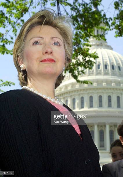 Sen Hillary Rodham Clinton listens during a press conference on reintroducing a bill to close the 'gun show loophole' April 24 2001 on Capitol Hill...