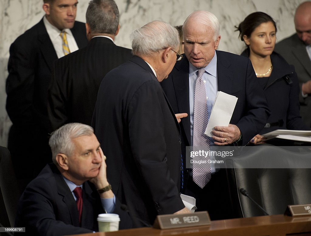 Sen. Jack Reed, D-RI., Chairman Carl Levin, D-MI., and Sen. John McCain, R-AZ., before the start of the Armed Services Committee hearing on pending legislation regarding sexual assaults in the military in the Senate Hart Office Building on June 4, 2013.