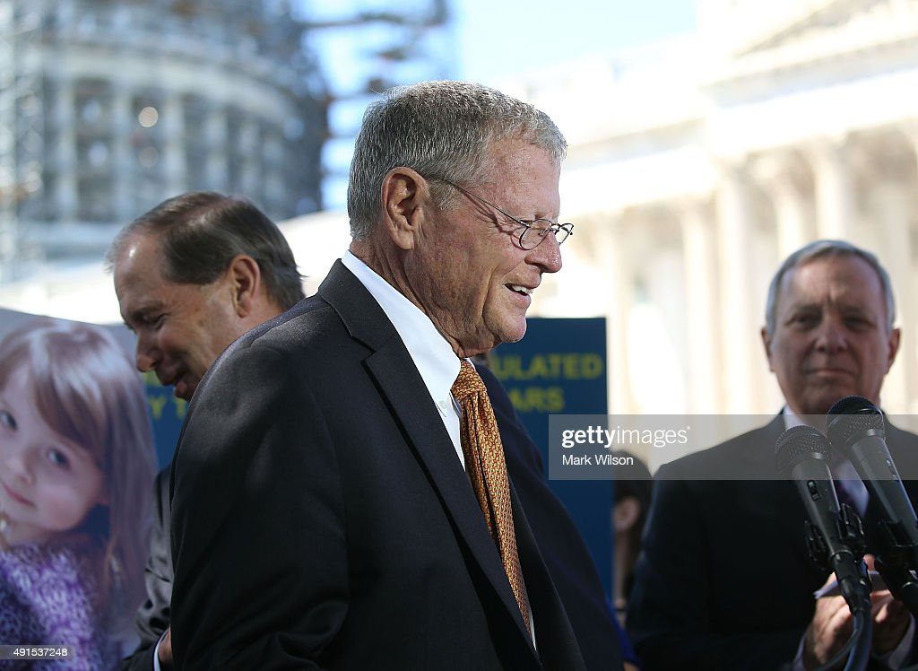 Sen. James Inhofe (R-OK) (C), joins Sen. 2 (D-NM)(L) and Sen. Richard Durbin (D-IL) (R) during a news conference on dangerous chemicals, on Capitol Hill October 6, 2015 in Washington, DC. Bonnie Lautenberg joined a bi-partisan group of Senators to urge Congress into passing the Lautenberg Act to protect families from dangerous chemicals.