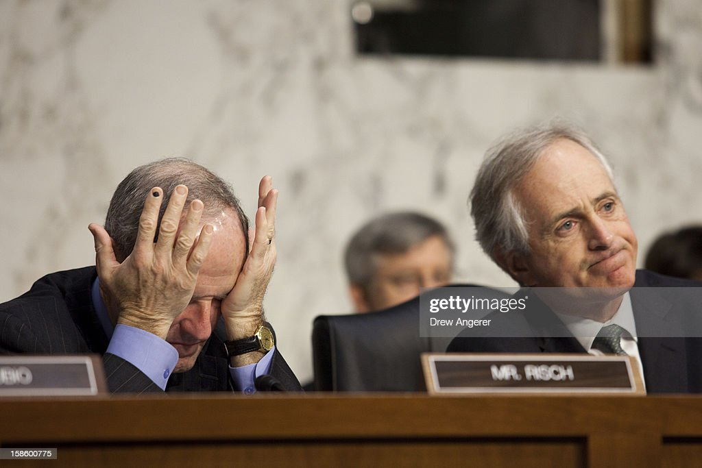 Sen. James Risch (R-ID) (L) and Sen. <a gi-track='captionPersonalityLinkClicked' href=/galleries/search?phrase=Bob+Corker&family=editorial&specificpeople=3986296 ng-click='$event.stopPropagation()'>Bob Corker</a> (R-IN) listen to testimony during the Senate Foreign Relations Committee hearing on the September 11th attacks on the U.S. Consulate in Benghazi, on Capitol Hill, December 20, 2012 in Washington, DC. Secretary of State Hillary Clinton had planned to testify at the hearing, but could not attend due to an illness.