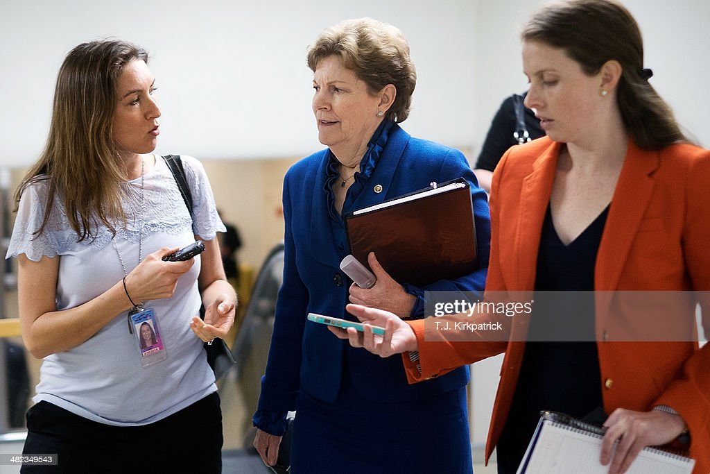 Sen. <a gi-track='captionPersonalityLinkClicked' href=/galleries/search?phrase=Jeanne+Shaheen&family=editorial&specificpeople=5591285 ng-click='$event.stopPropagation()'>Jeanne Shaheen</a> (D-NH), center, talks with reporters on her way to the Senate Chamber to vote on the Reed-Heller unemployment insurance bill on April 3, 2014 in Washington, DC. The bill, which cleared a final hurdle and is expected to pass the Senate on Monday, would reinstate emergency unemployment insurance benefits for five months.
