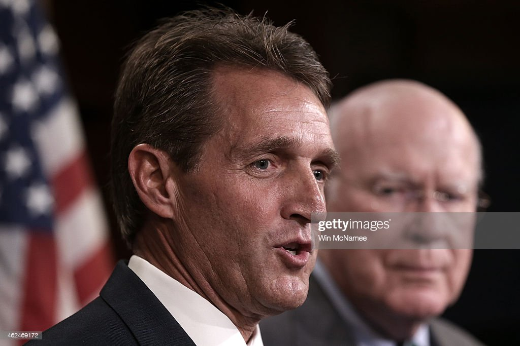 Sen. <a gi-track='captionPersonalityLinkClicked' href=/galleries/search?phrase=Jeff+Flake&family=editorial&specificpeople=2474871 ng-click='$event.stopPropagation()'>Jeff Flake</a> (R-AZ), and Sen. Patrick Leahy (D-VT) speak at a press conference on Cuba at the U.S. Capitol January 29, 2015 in Washington, DC. Flake is introducing legislation with bipartisan support that would lift a longstanding ban on U.S. citizens traveling freely to Cuba.