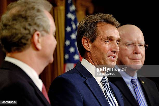 Sen Jeff Flake center Sen Patrick Leahy right and Rep Chris Van Hollen talk about their efforts to retrieve US contractor Alan Gross from prison in...