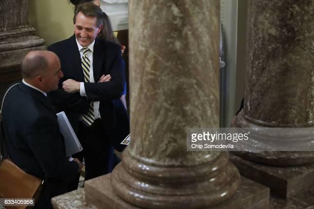 Sen Jeff Flake has a conversation between votes at the US Capitol February 1 2017 in Washington DC Sen Susan Collins and Sen Lisa Murkowski have both...