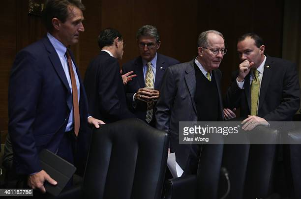 S Sen Jeff Flake looks on as discussions between Sen Mike Lee and Sen Lamar Alexander and Sen Joe Manchin and Sen John Barrasso go on prior to a...