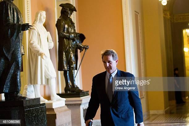 Sen Jeff Flake makes his way toward the Senate floor on Capitol Hill November 21 2013 in Washington DC The Senate voted 5248 to invoke the socalled...