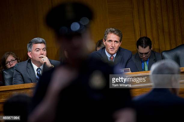 Sen Jeff Flake RAriz asks Secretary of State John Kerry a question as Sen Cory Gardner RColo looks on during a Senate Foreign Relations Committee...