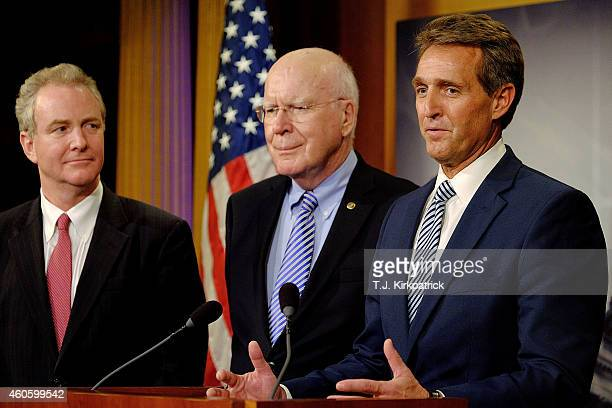 Sen Jeff Flake right with Rep Chris Van Hollen left and Sen Patrick Leahy talk about their efforts to retrieve US contractor Alan Gross from prison...