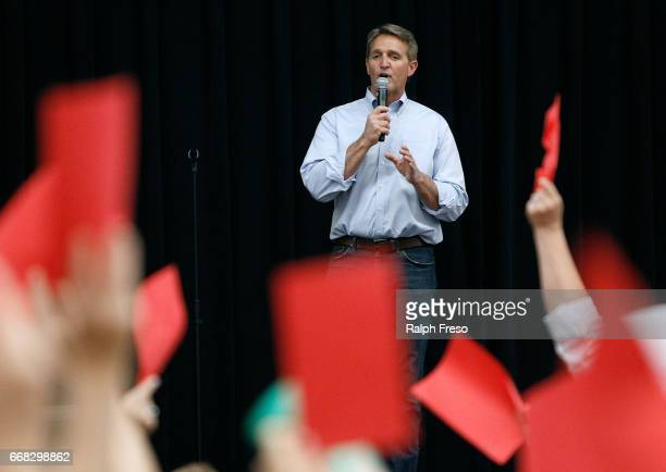 S Sen Jeff Flake speaks at a town hall event as critics show their displeasure at the Mesa Convention Center on April 13 2017 in Mesa Arizona It was...