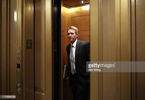 S Sen Jeff Flake stands in an elevator June 27 2013 at the US Capitol in Washington DC The Senate is scheduled to vote on the final passage of the...