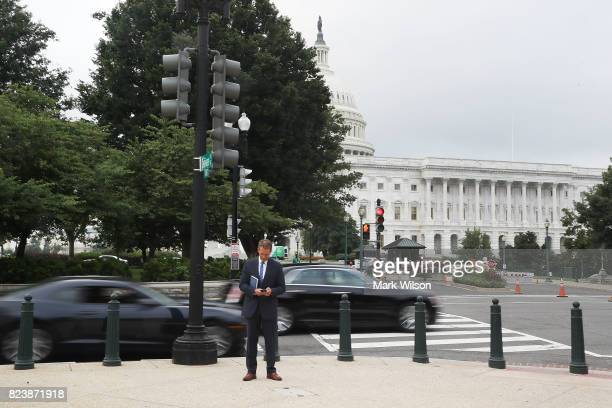 Sen Jeff Flake stands near the US Capitol hours after voting on the GOP 'Skinny Repeal' health care bill on July 28 2017 in Washington DC Three...