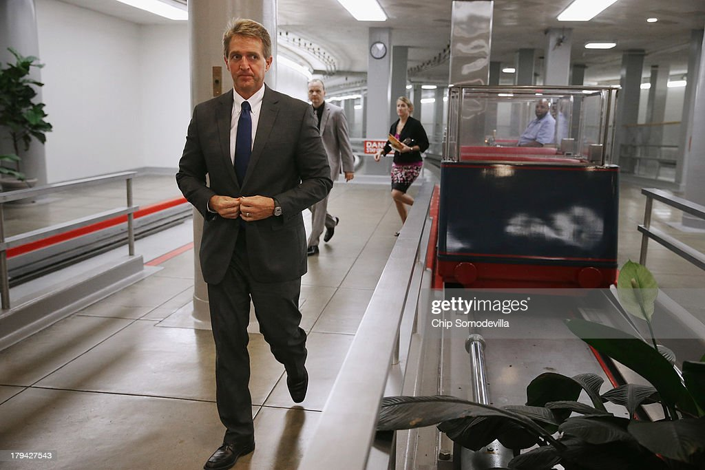Sen. <a gi-track='captionPersonalityLinkClicked' href=/galleries/search?phrase=Jeff+Flake&family=editorial&specificpeople=2474871 ng-click='$event.stopPropagation()'>Jeff Flake</a> (R-AZ) (C) talks to reporters before heading into a members-only classified briefing about Syria at the U.S. Capitol September 3, 2013 in Washington, DC. The Foreign Relations Committee will hear testimony today from Secretary of State John Kerry, Secretary of Defense Chuck Hagel and Chairman of the Joint Chiefs of Staff Gen. Martin Dempsey.