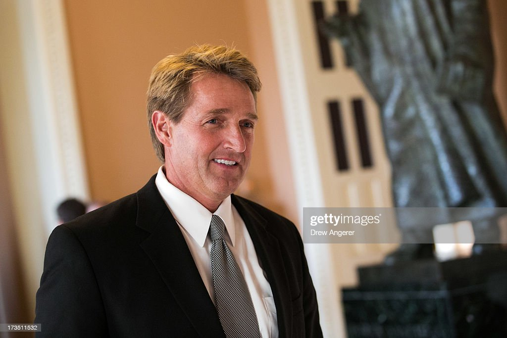 Sen. Jeff Flake (R-AZ) walks to a Senate joint caucus meeting, on Capitol Hill, July 15, 2013 in Washington, DC. The senators met in a closed-session in the Old Senate Chamber Wednesday evening to discuss the subjects of filibusters and presidential nominations.