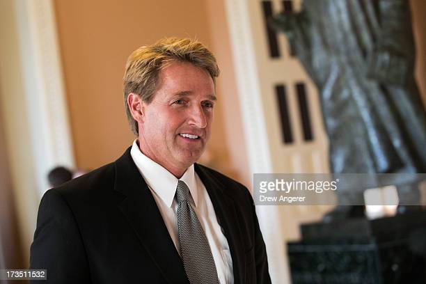 Sen Jeff Flake walks to a Senate joint caucus meeting on Capitol Hill July 15 2013 in Washington DC The senators met in a closedsession in the Old...