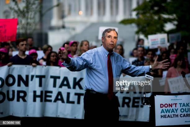 Sen Jeff Merkley DOre speaks to health care protesters outside of the Capitol on Thursday July 27 as the Senate began its 'VoteARama' series of votes...