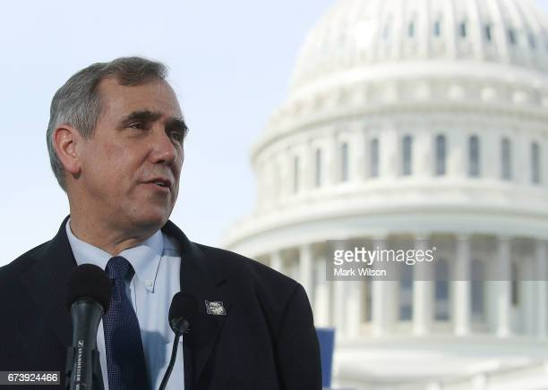 Sen Jeff Merkley speaks during a news conference on climate change on Capitol Hill April 27 2017 in Washington DC Senators introduced 'The 100 by '50...