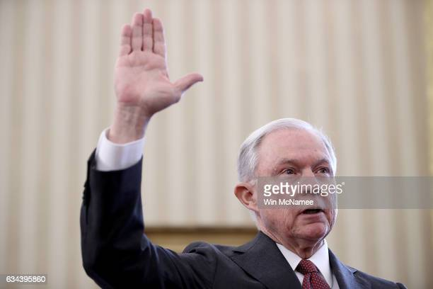 Sen Jeff Sessions is sworn in as the new US Attorney General by US Vice President Mike Pence in the Oval Office of the White House February 9 2017 in...