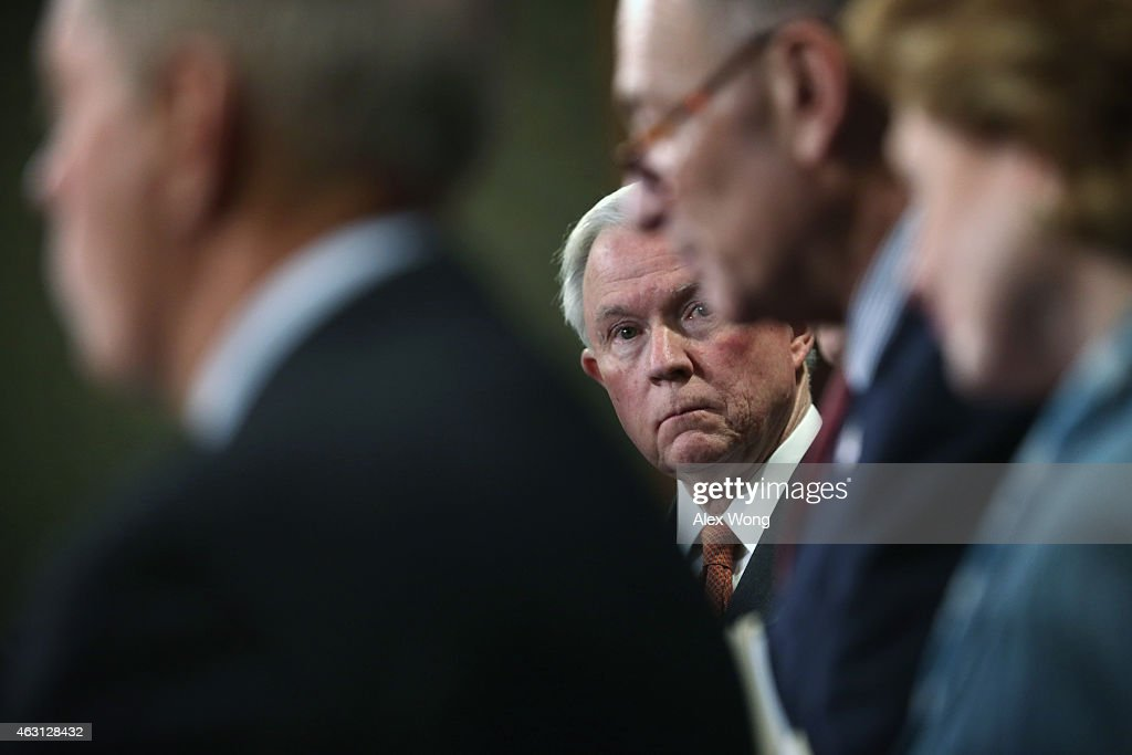 U.S. Sen. <a gi-track='captionPersonalityLinkClicked' href=/galleries/search?phrase=Jeff+Sessions&family=editorial&specificpeople=534346 ng-click='$event.stopPropagation()'>Jeff Sessions</a> (R-AL) listens during a news conference on currency and trade February 10, 2015 on Capitol Hill in Washington, DC. A group of bipartisan senators will introduce the Currency Exchange Rate Oversight Reform Act of 2015 to combat currency manipulation and create jobs as the same time.
