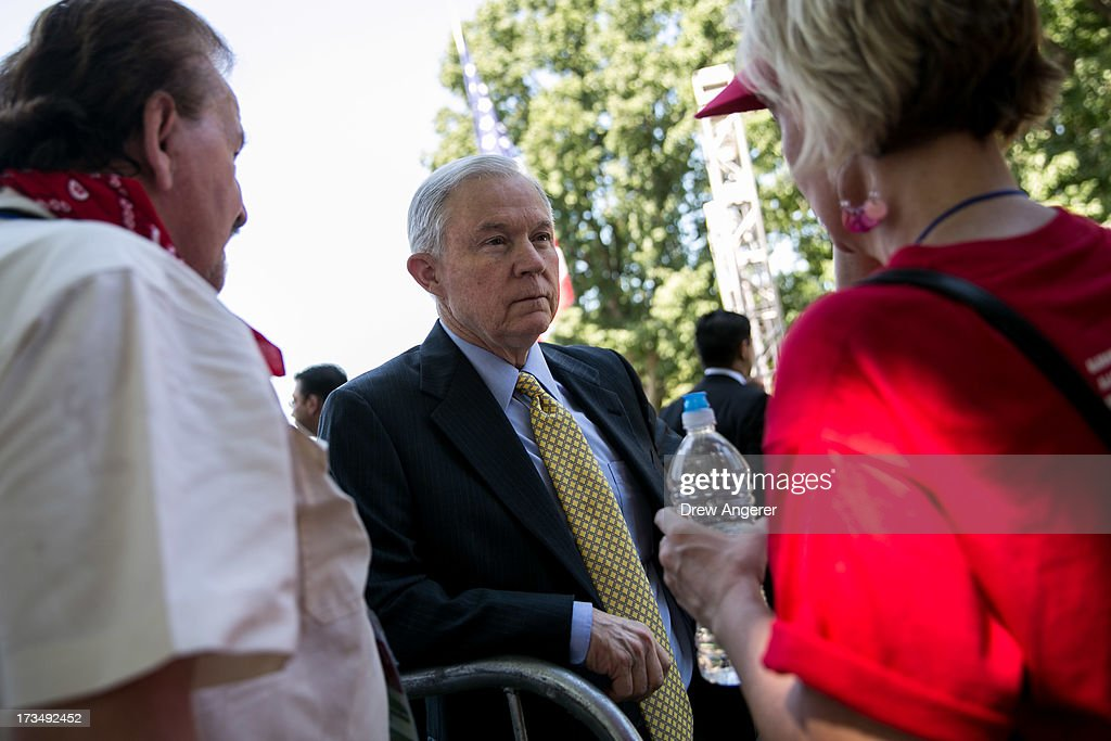 Sen. <a gi-track='captionPersonalityLinkClicked' href=/galleries/search?phrase=Jeff+Sessions&family=editorial&specificpeople=534346 ng-click='$event.stopPropagation()'>Jeff Sessions</a> (R-AL) talks with supporters during the DC March for Jobs in Upper Senate Park near Capitol Hill, on July 15, 2013 in Washington, DC. Conservative activists and supporters rallied against the Senate's immigration legislation and the impact illegal immigration has on reduced wages and employment opportunities for some Americans.