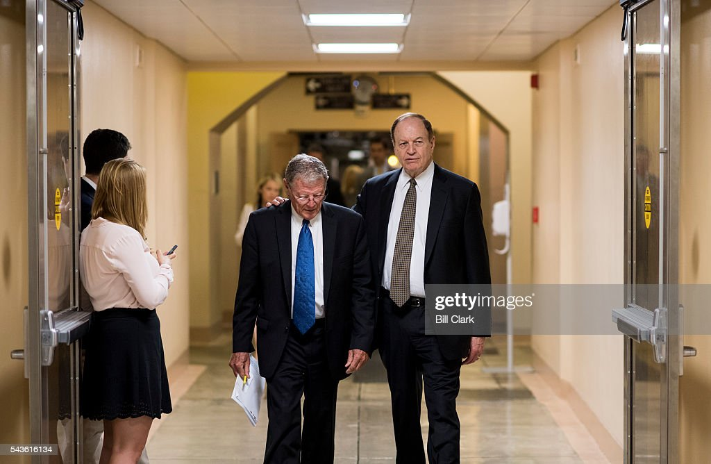 Sen. Jim Inhofe (R-OK) left and Sen. Richard Shelby (R-AL) talk as they head to the Senate subway in the Capitol following a vote on Wednesday, June 29, 2016.