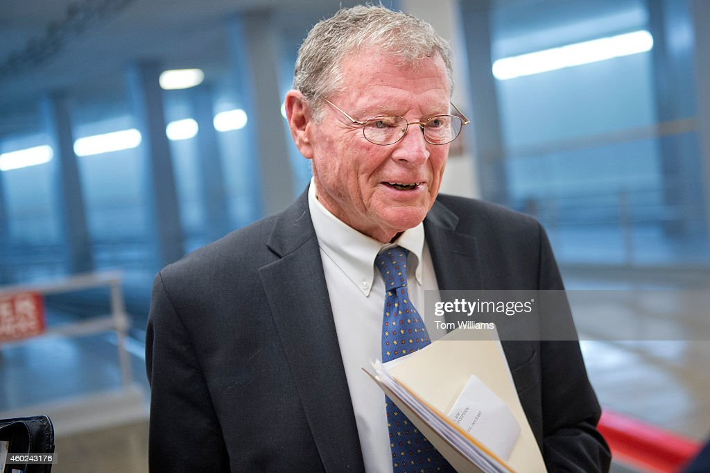 Sen. <a gi-track='captionPersonalityLinkClicked' href=/galleries/search?phrase=Jim+Inhofe&family=editorial&specificpeople=534276 ng-click='$event.stopPropagation()'>Jim Inhofe</a>, R-Okla., talks with a reporter in the senate subway, December 10, 2014.