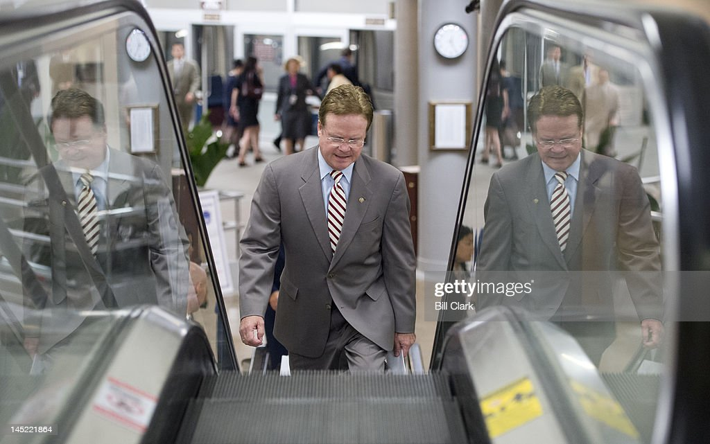 Sen. Jim Webb, D-Va., arrives in the Capitol via the Senate subway for votes on the Food and Drug Administration reauthorization bill on Thursday, May 24, 2012.