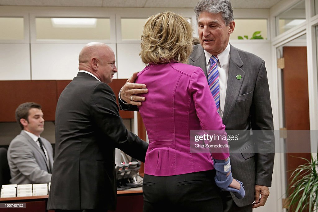 U.S. Sen. <a gi-track='captionPersonalityLinkClicked' href=/galleries/search?phrase=Joe+Manchin&family=editorial&specificpeople=568465 ng-click='$event.stopPropagation()'>Joe Manchin</a> (D-WV) (R) greets shooting victim, former Rep. <a gi-track='captionPersonalityLinkClicked' href=/galleries/search?phrase=Gabrielle+Giffords&family=editorial&specificpeople=6961081 ng-click='$event.stopPropagation()'>Gabrielle Giffords</a> (D-AZ) (C) and her husband and retired astronaut <a gi-track='captionPersonalityLinkClicked' href=/galleries/search?phrase=Mark+Kelly+-+Astronaut+and+Gun+Control+Advocate&family=editorial&specificpeople=566699 ng-click='$event.stopPropagation()'>Mark Kelly</a> at Manchin's office in the Hart Senate Office Building on Capitol Hill April 16, 2013 in Washington, DC. Giffords and Kelly met with members of Congress, including Manchin and Sen. Pat Toomey (R-PA), who have sponsored legislation to expand the background check system for gun sales.
