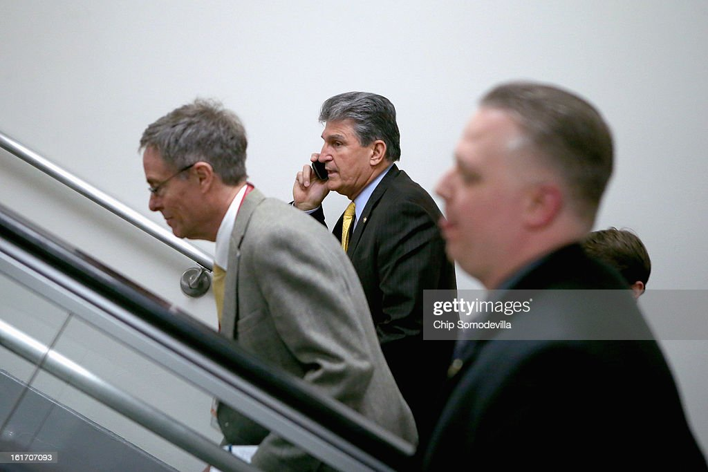 Sen. <a gi-track='captionPersonalityLinkClicked' href=/galleries/search?phrase=Joe+Manchin&family=editorial&specificpeople=568465 ng-click='$event.stopPropagation()'>Joe Manchin</a> (D-WV) (C) heads to the Senate chamber to vote for cloture on the confirmation of former Sen. Chuck Hagel (R-NE) to be the next Secretary of State at the U.S. Capitol February 14, 2013 in Washington, DC. Senate Republican leaders, including Sen. John McCain (R-AZ) and Sen. Lindsey Graham (R-SC), have been leading the charge against Hagel's confirmation.