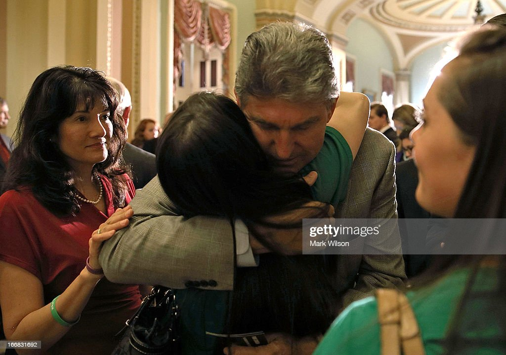 U.S. Sen. <a gi-track='captionPersonalityLinkClicked' href=/galleries/search?phrase=Joe+Manchin&family=editorial&specificpeople=568465 ng-click='$event.stopPropagation()'>Joe Manchin</a> (D-WV) (3rd L) hugs Sandy Hook victim Vicki Soto's sister Carlee Soto (2nd L), as Sandy Hook victim Dawn Hochsprung's daughter Erica Lafferty (R); and Tucson, Arizona, shooting victim Christina Taylor Green's mother Roxanna Green (L) look on after a vote on the Senate floor April 17, 2013 on Capitol Hill in Washington, DC. The Senate rejected a proposal by Sens. <a gi-track='captionPersonalityLinkClicked' href=/galleries/search?phrase=Joe+Manchin&family=editorial&specificpeople=568465 ng-click='$event.stopPropagation()'>Joe Manchin</a> (D-WV) and Pat Toomey (R-PA) to expand background checks on firearms purchases and to close the so-called gun-show loophole.